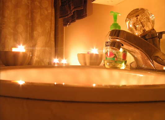 A bathroom basin in candle light to creat a Feng Shui ambience