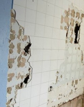 Tiles on a wall that are damaged because  they were not properly waterproofed