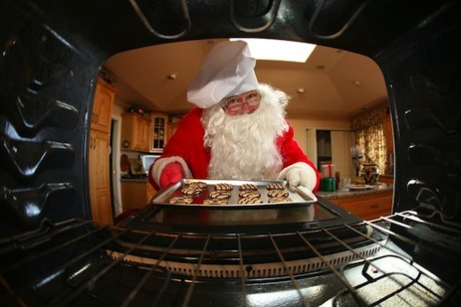 Santa taking Cookies out of the oven