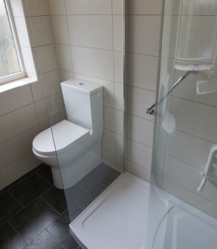 Mrs Rippon's bespoke bathroom with fitted shower unit and toilet