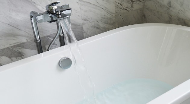 A tap filling water into a bathtub