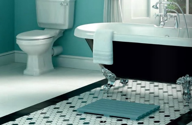 Blue bathroom theme with patterned floor tiles
