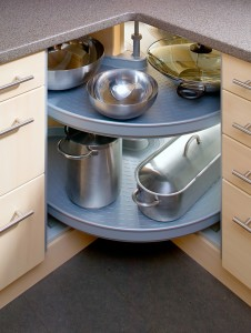 carousel racking in corner cupboard with pots and pans