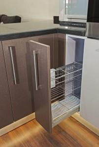 Dark wood skinny cupboard in kitchen