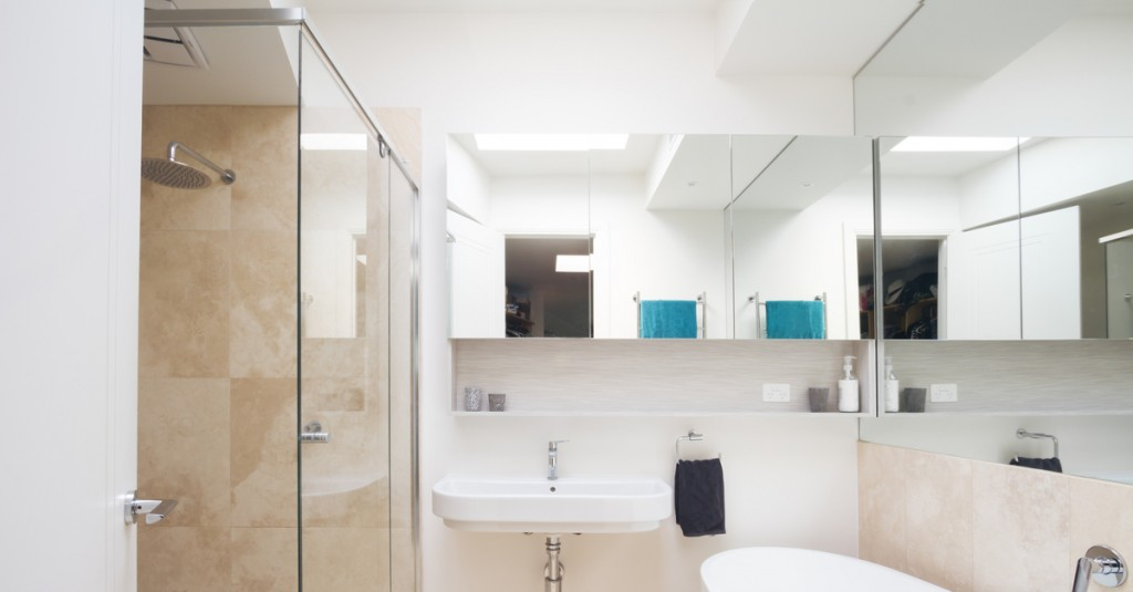 Mirrors provide light and a sense to space to cramped bathrooms.