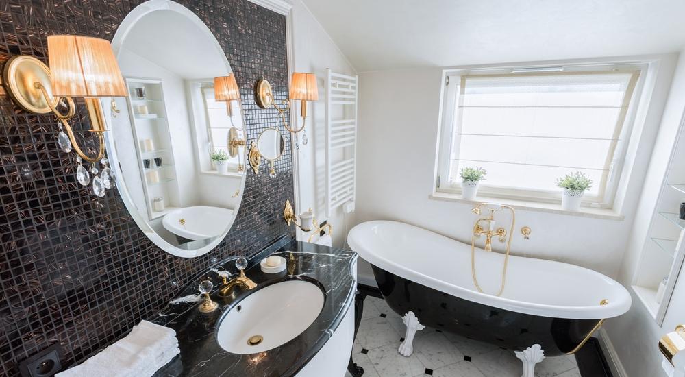 Black mosaic tiles in bathroom